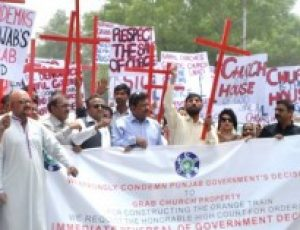 Pakistani Christians protest against churches being demolished to make way for new train line